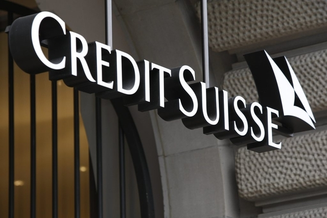 Logo of the Credit Suisse at the entrance of the headquarter in Zurich, Switzerland, Thursday, October 22, 2009. Credit Suisse Group reported a 2.4 billion Swiss franc (Euro 1.9 billion, $2.4 billion) net income during the third quarter as it continued strengthening its position following losses caused by the economic crisis. (KEYSTONE/Steffen Schmidt)